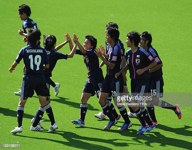 Yuka Momiki celebrates with teammates after she scored from a free kick during the FIFA U17 Women's World Cup 2012 group C match between Japan and...