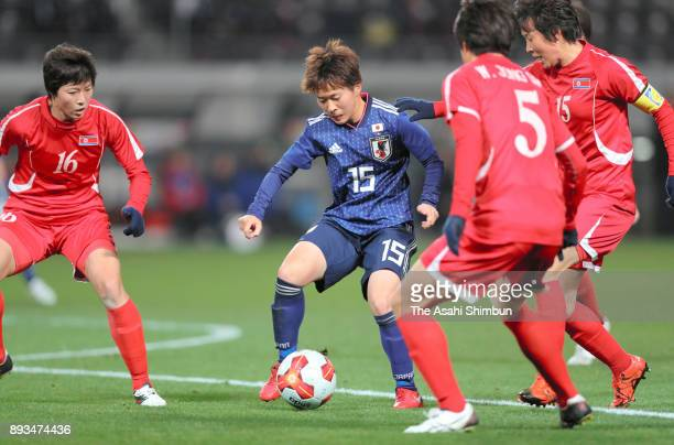 Yuka Momiki of Japan controls the ball under pressure of North Korean defense during the EAFF E1 Women's Football Championship between Japan and...