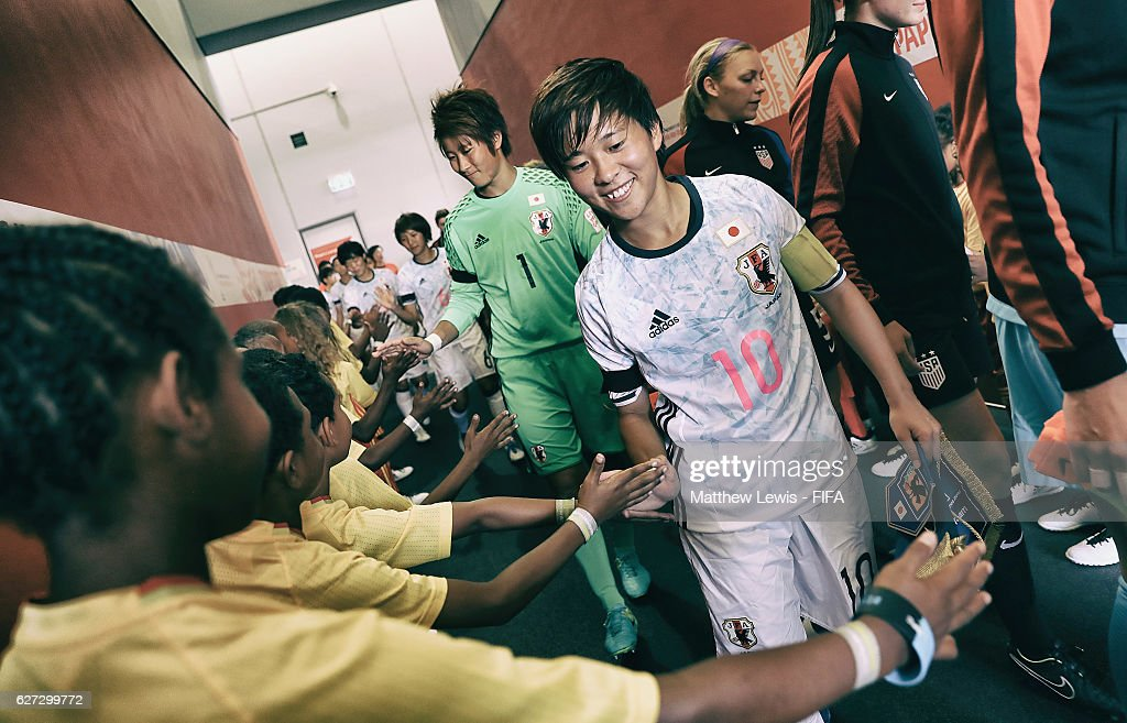 Yuka Momiki of Japan is welcomed by the player mascots as she walks to the pitch during the FIFA U-20 Women's World Cup Papua New Guinea 2016 Third Place Play Off match between USA and Japan at the National Football Stadium on December 3, 2016 in Port Moresby, Papua New Guinea.