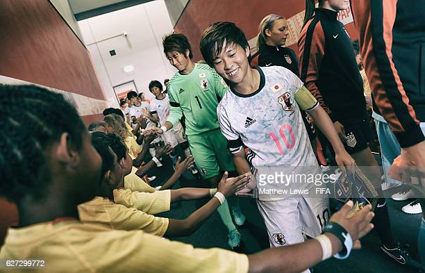 Yuka Momiki of Japan is welcomed by the player mascots as she walks to the pitch during the FIFA U20 Women's World Cup Papua New Guinea 2016 Third...