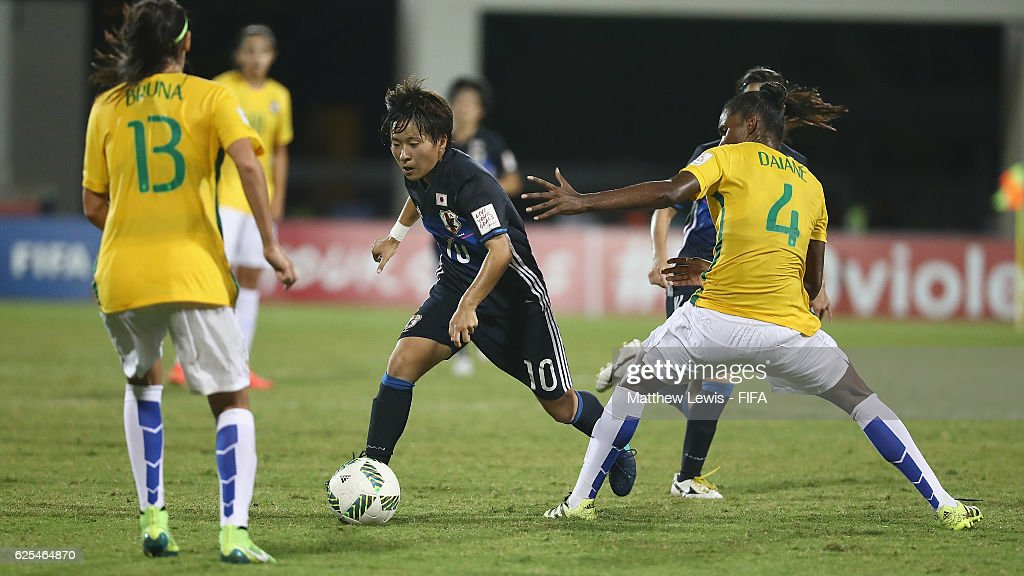 Yuka Momiki of Japan looks to break through the Brazil defence during the FIFA U-20 Women's World Cup Papua New Guinea 2016 Quarter Final match between Japan and Brazil at the National Footbal Stadium on November 24, 2016 in Port Moresby, Papua New Guinea.