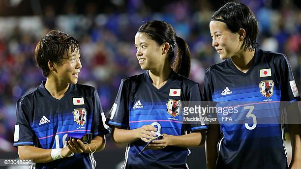 Yuka Momiki of Japan talks with Yui Hasegawa and Hikaru Kitagawa before their Group B match against Nigeria of the FIFA U20 Women's World Cup Papua...