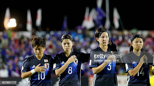 Yuka Momiki of Japan Yui Hasegawa Hikaru Kitagawa and Narumi Miura stand for the playing of the Japanese National Anthem before their Group B in the...