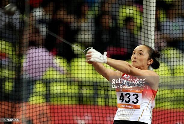 Yuka Murofushi of Japan competes in the Women�s Hammer Throw Final at Aoti Main Stadium during day ten of the 16th Asian Games Guangzhou 2010 on...
