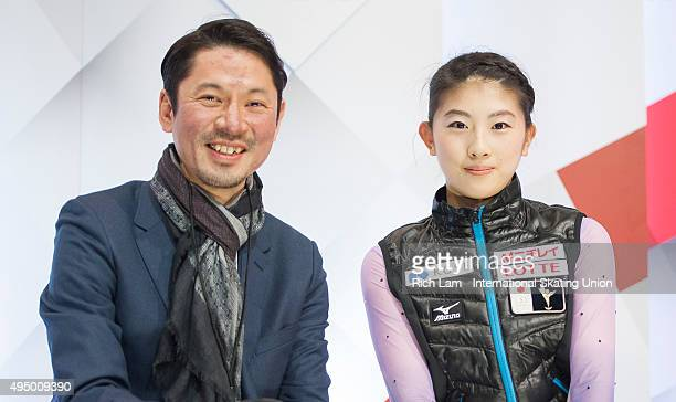 Yuka Nagai of Japan and her coach Megumu Seki wait for her results in the Ladies Short Program on day one of Skate Canada International ISU Grand...