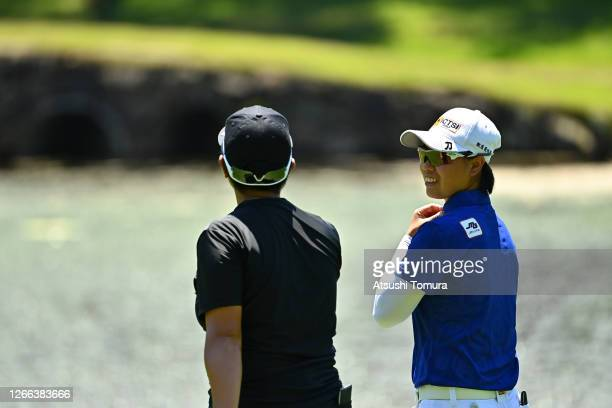 Yuka Saso and Haruka Kudo of Japan talk on the 5th hole during the second round of the NEC Karuizawa 72 Golf Tournament at the Karuizawa 72 Golf Kita...