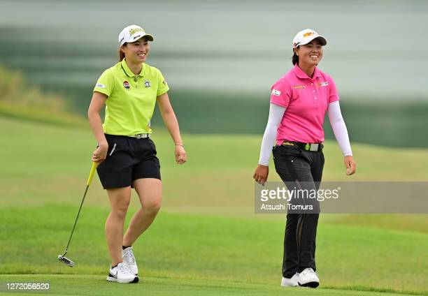 Yuka Saso and Rieru Shibusawa of Japan share a laugh on the 18th fairway during the third round of the JLPGA Championship Konica Minolta Cup at the...