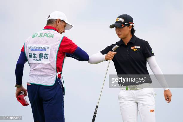 Yuka Saso of Japan elbow bumps with her caddie after holing out on the 9th green during the second round of the JLPGA Championship Konica Minolta Cup...