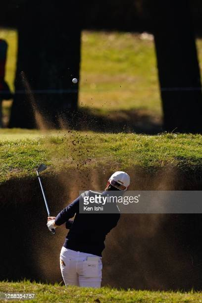 Yuka Saso of Japan hits out from a bunker on the 9th hole during the final round of the JLPGA Tour Championship Ricoh Cup at the Miyazaki Country...