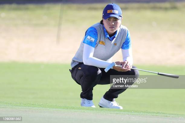 Yuka Saso of Japan looks over a putt on the 12th green during the first round of the 75th U.S. Women's Open Championship at Champions Golf Club...