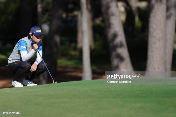 Yuka Saso of Japan looks over a putt on the seventh green during the first round of the 75th U.S. Women's Open Championship at Champions Golf Club...