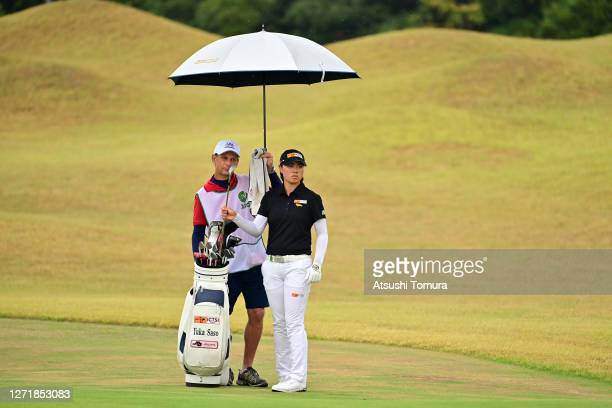 Yuka Saso of Japan picks up an iron before her third shot on the 2nd hole during the second round of the JLPGA Championship Konica Minolta Cup at the...