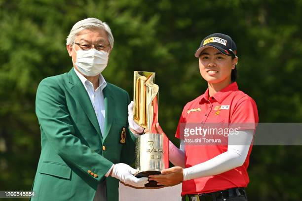 Yuka Saso of Japan receives the trophy at the award ceremony following the final round of the NEC Karuizawa 72 Golf Tournament at the Karuizawa 72...