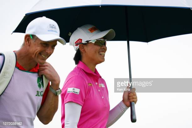Yuka Saso of Japan shares a laugh with her caddie on the 3rd hole during the third round of the JLPGA Championship Konica Minolta Cup at the JFE...