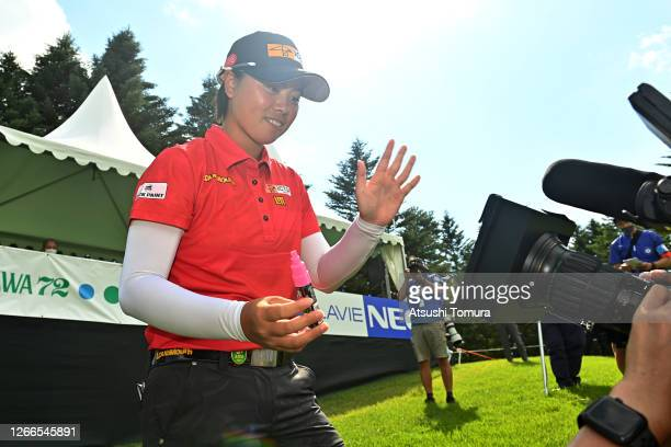 Yuka Saso of Japan signs her autograph for the television crews after winning the tournament after the final round of the NEC Karuizawa 72 Golf...