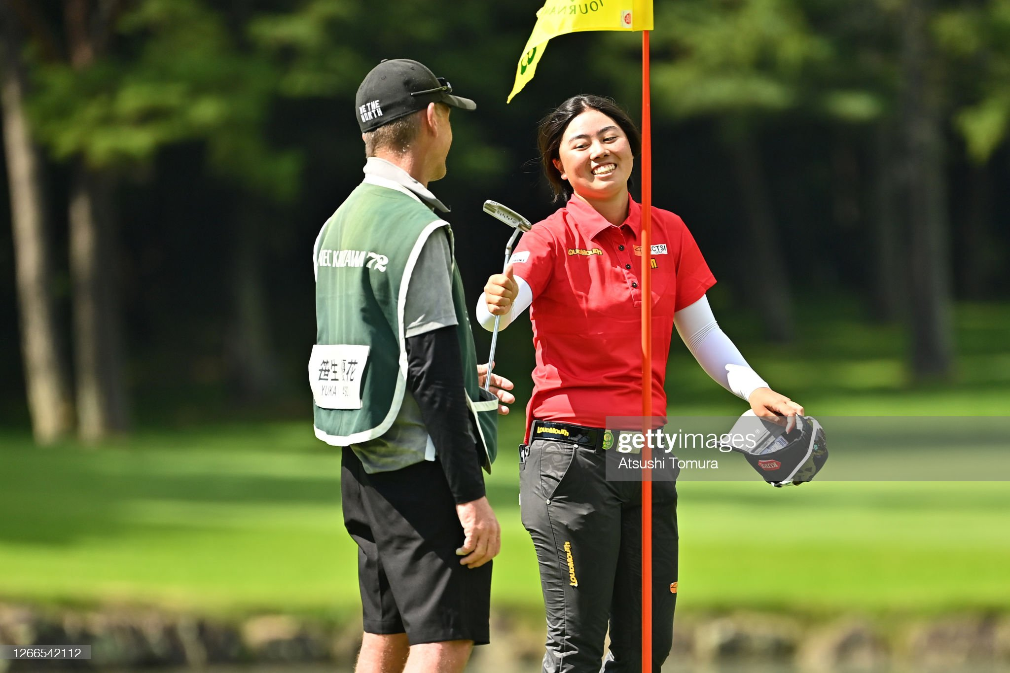 https://media.gettyimages.com/photos/yuka-saso-of-japan-smiles-after-holing-out-on-the-18th-green-during-picture-id1266542112?s=2048x2048
