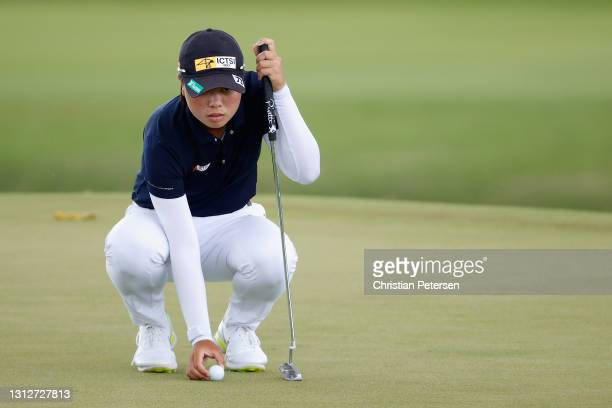Yuka Saso of the Philippines lines up a putt on the 12th green during the second round of the LPGA LOTTE Championship at Kapolei Golf Club on April...