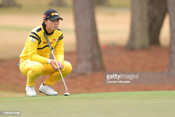 Yuka Saso of the Philippines looks over a putt on the tenth green during the third round of the 75th U.S. Women's Open Championship at Champions Golf...