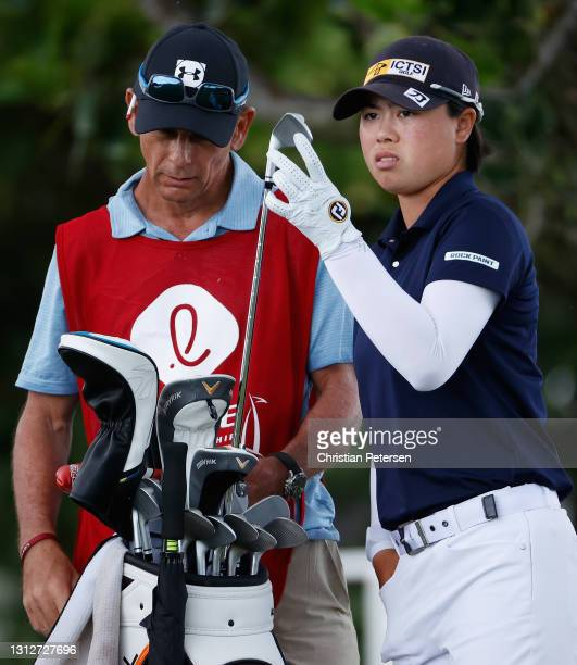 Yuka Saso of the Philippines takes a club from her bag on the 12th hole during the second round of the LPGA LOTTE Championship at Kapolei Golf Club...