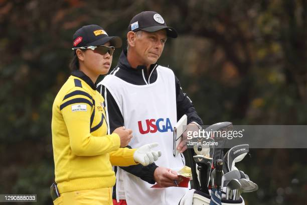 Yuka Saso of the Philippines talks with her caddie, Lionel Matichuk, on the third hole during the third round of the 75th U.S. Women's Open...