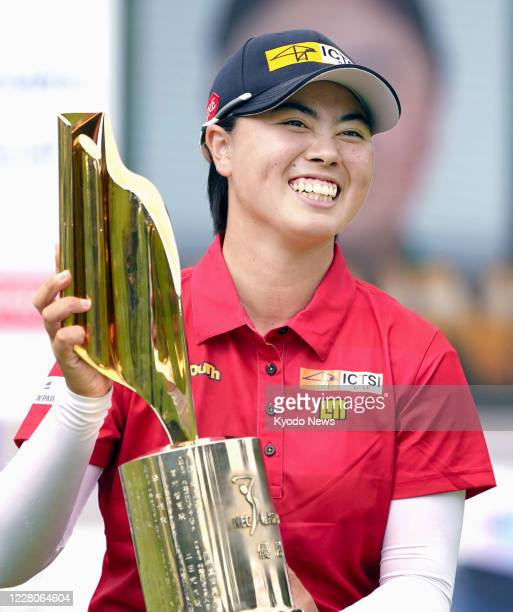 Yuka Saso poses for a photo with the trophy after winning the NEC Karuizawa 72 golf tournament in Karuizawa in Nagano Prefecture, central Japan, on...