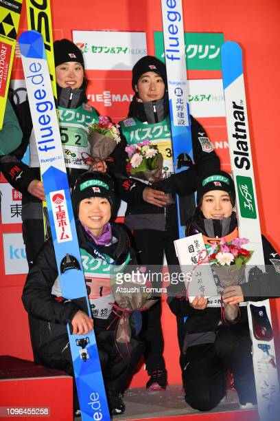 Yuka Seto Kaori Iwabuchi Yuki Ito and Sara Takanashi of Japan pose on the podium during day two of the FIS Ski Jumping World Cup Ladies Zao at...