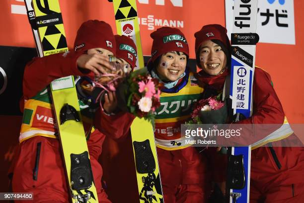 Yuka Seto Sara Takanashi Yuki Ito and Kaori Iwabuchi of Japan celebrate on the podium after winning the Ladies' Team HS102 during day three of the...