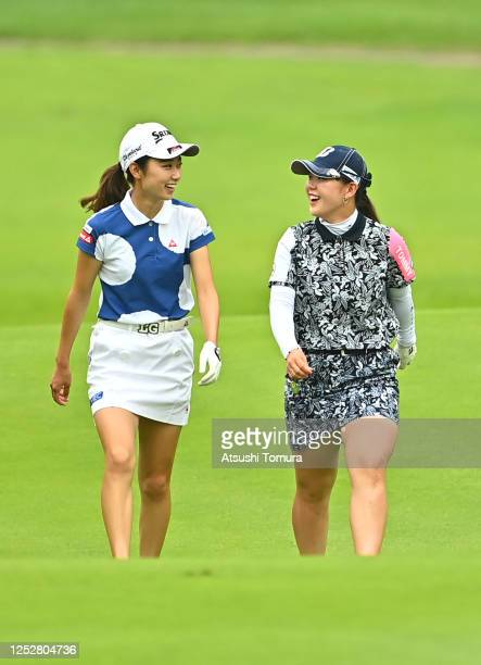 Yuka Yasuda and Yuri Yoshida of Japan talk on the fairway on the 11th hole during the third round of the Earth Mondamin Cup at the Camellia Hills...