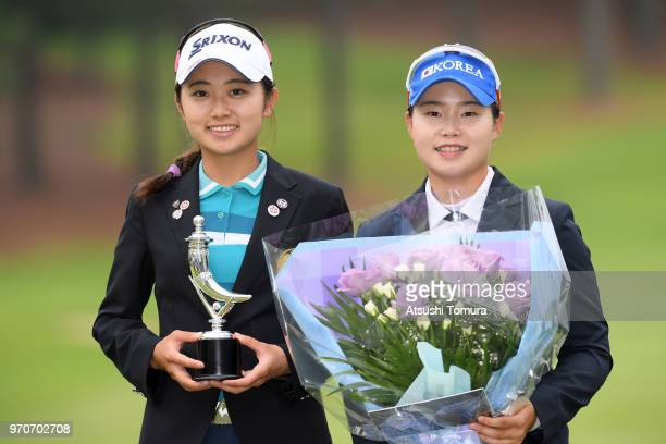 Yuka Yasuda of Japan and Heejeong Lim of South Korea pose for photographers during the final round of the Suntory Ladies Open Golf Tournament at the...