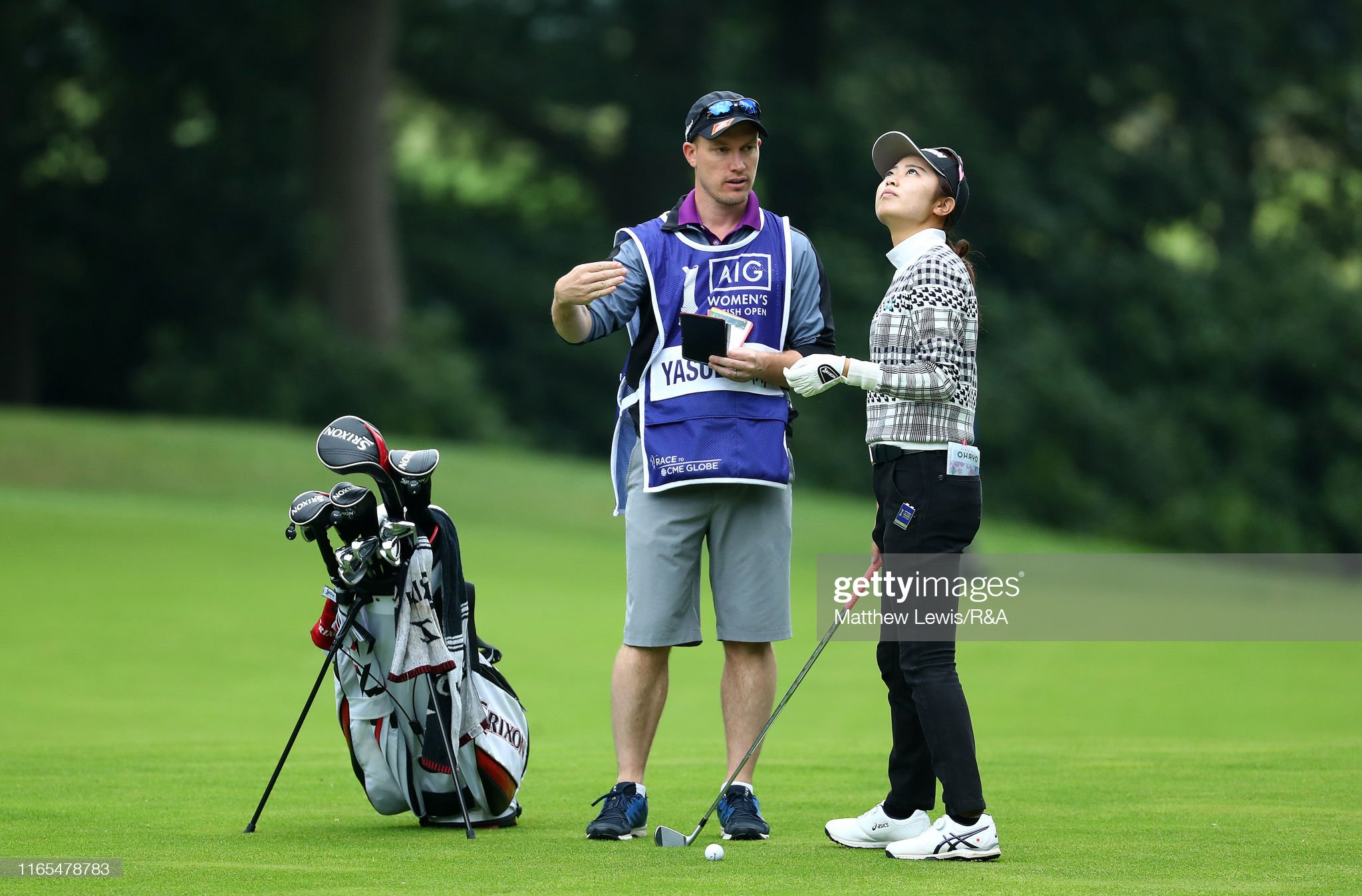 https://media.gettyimages.com/photos/yuka-yasuda-of-japan-looks-on-with-her-caddie-during-day-one-of-the-picture-id1165478783?s=2048x2048