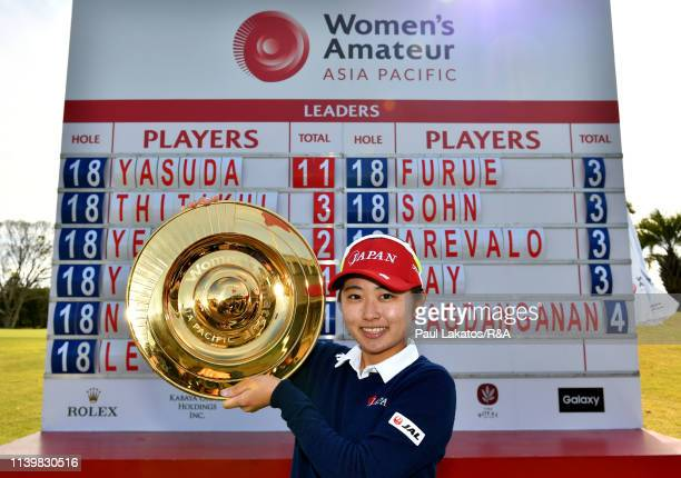 Yuka Yasuda of Japan pictured with the winner's trophy during day 4 of the Women's Amateur Asia-Pacific Championship at The Royal Golf Club on April...
