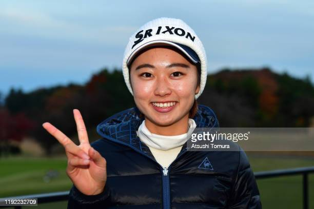 Yuka Yasuda of Japan poses for photographs after the final round of the Japanese LPGA Final Qualifying Tournament at Kodama Golf Club on December 6...