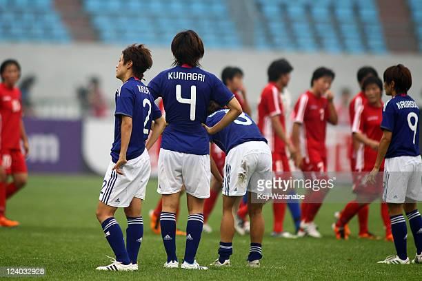 Yukari Kinga and Saki Kumagai of Japan react after the London Olympic Women's Football Asian Qualifier match between North Korea and Japan at...