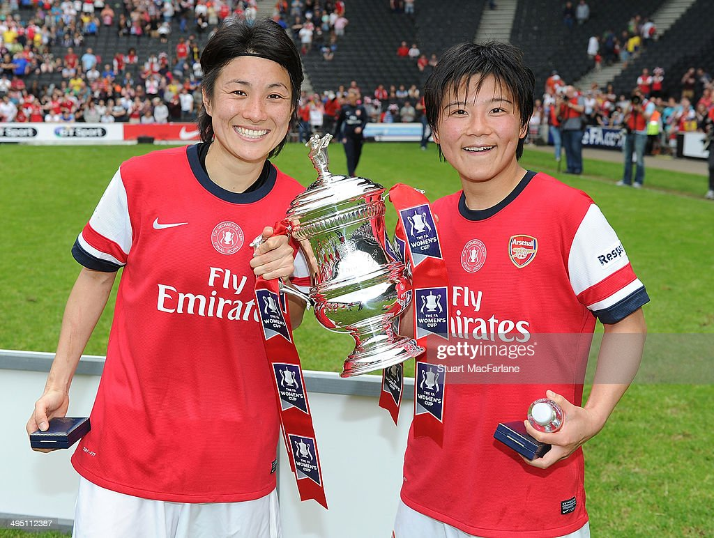 Yukari Kinga and Shinobu Ohno with the FA Cup after Arsenal's win against Everton at Stadium mk on June 1, 2014 in Milton Keynes, England.