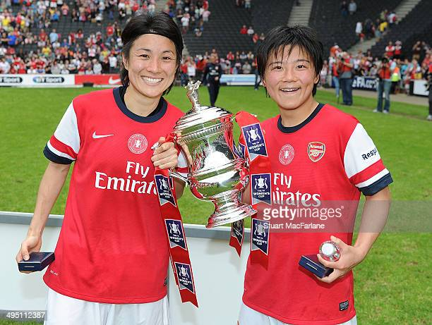 Yukari Kinga and Shinobu Ohno with the FA Cup after Arsenal's win against Everton at Stadium mk on June 1 2014 in Milton Keynes England
