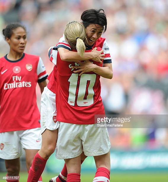 Yukari Kinga celebrates scoring the 2nd Arsenal goal with Kelly Smith during the match at Stadium mk on June 1 2014 in Milton Keynes England