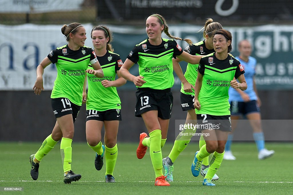 Yukari Kinga of Canberra celebrates scoring a goal with team mates during the round 10 W-League match between Sydney and Canberra at Lambert Park on January 3, 2017 in Sydney, Australia.