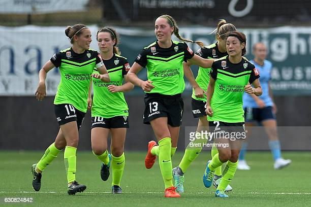 Yukari Kinga of Canberra celebrates scoring a goal with team mates during the round 10 WLeague match between Sydney and Canberra at Lambert Park on...