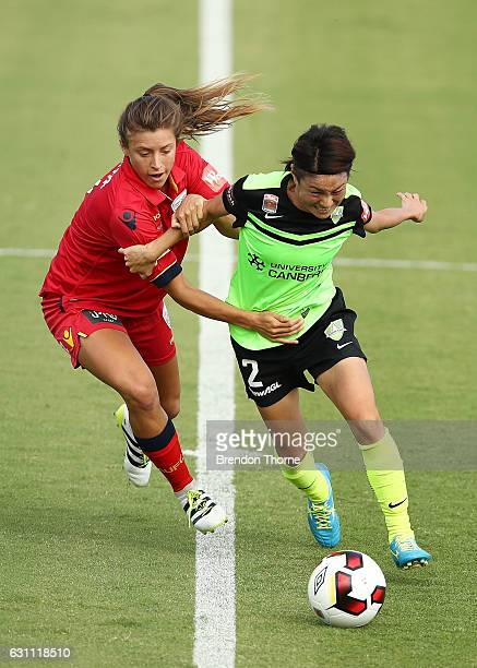 Yukari Kinga of Canberra competes with Sofia Huerta of Adelaide during the round 11 WLeague match between Canberra United and Adelaide United at...