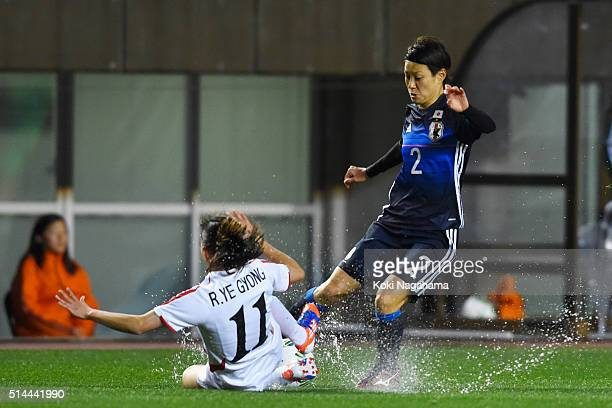 Yukari Kinga of Japan and Ri Ye Gyong of North Korea compete for the ball during the AFC Women's Olympic Final Qualification Round match between...