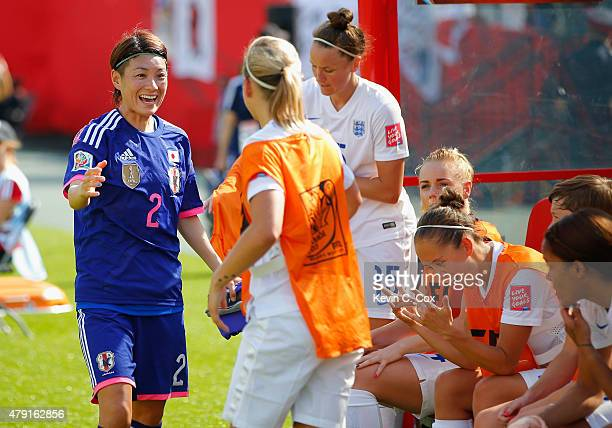 Yukari Kinga of Japan speaks to the England subs during the FIFA Women's World Cup Semi Final match between Japan and England at the Commonwealth...