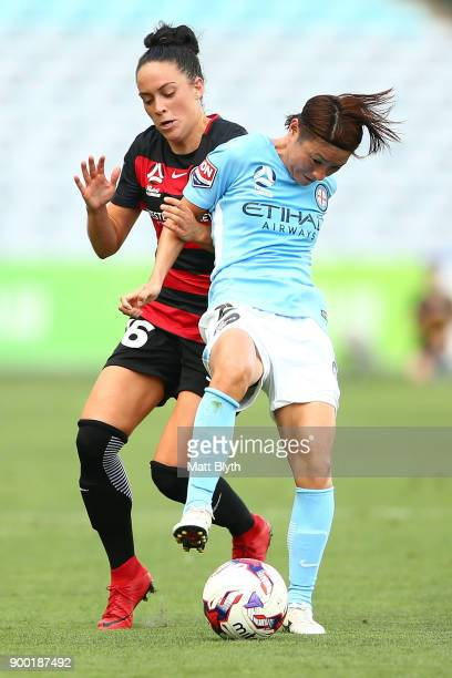 Yukari Kinga of Melbourne City and Alix Roberts of the Wanderers compete for the ball during the round nine WLeague match between the Western Sydney...