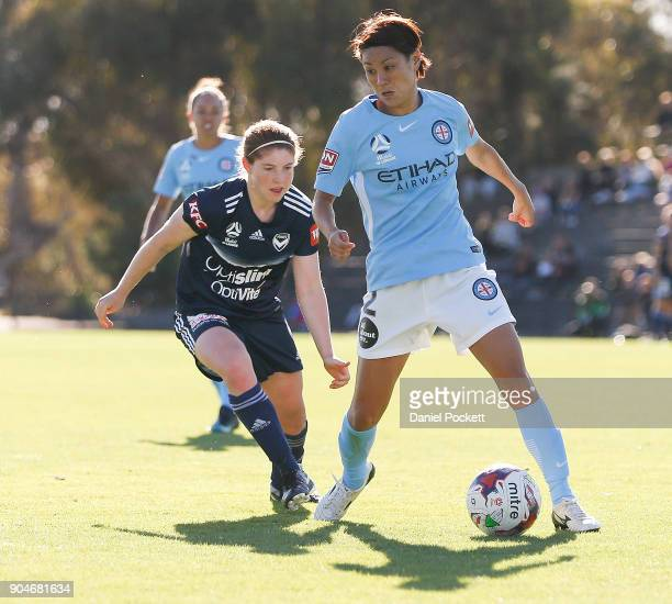 Yukari Kinga of Melbourne City and Annabel Martin of Melbourne Victory contest the ball during the round 11 WLeague match between the Melbourne...