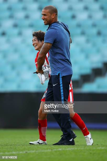 Yukari Kinga of Melbourne City and Melbourne City coach Patrick Kisnorbo celebrate victory during the WLeague Grand Final match betweenSydney FC and...