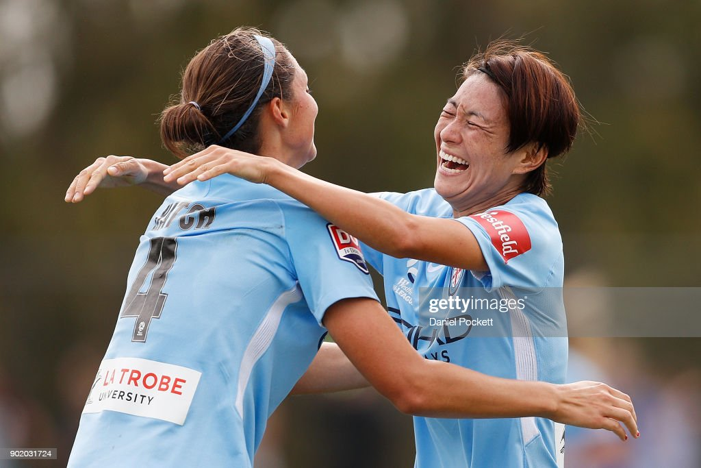 Yukari Kinga of Melbourne City celebrates a goal with Ashley Hatch of Melbourne City during the round ten W-League match between Melbourne City and Perth Glory at City Football Academy, Bundoora on January 7, 2018 in Melbourne, Australia.