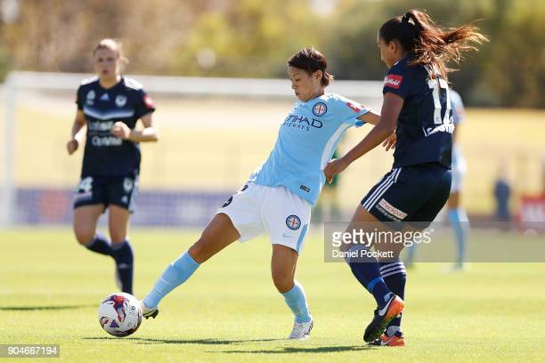 Yukari Kinga of Melbourne City passes the ball during the round 11 WLeague match between the Melbourne Victory and Melbourne City at Epping Stadium...