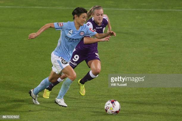 Yukari Kinga of Melbourne City runs with the ball under pressure from Rachel Hill of the Glory during the round one WLeague match between the Perth...