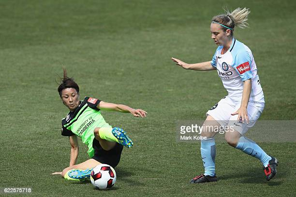 Yukari Kinga of United slides to secure the ball from Marianna Tabain of City FC during the round two WLeague match between Canberra United and...