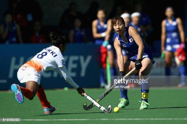 Yukari Mano of Japan and Nikki Pradhan of India battle for possession during the 5th8th Place playoff match between India and Japan during Day 7 of...