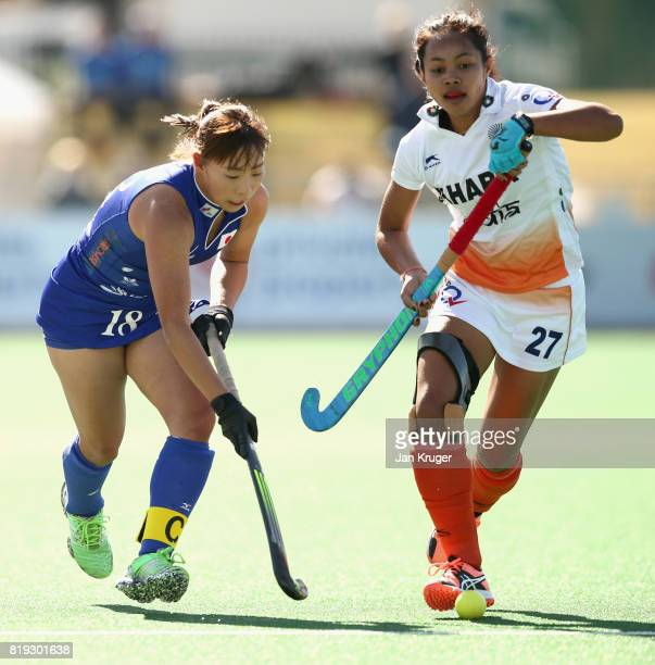 Yukari Mano of Japan and Sushila Pukhrambam of India battle for possession during the 5th8th Place playoff match between India and Japan during Day 7...
